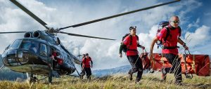 Search and rescue team leaving helicopter