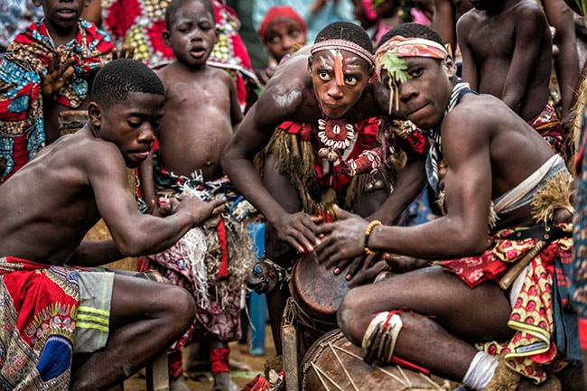 Bwiti tribes drumming at sunrise after an iboga ceremony