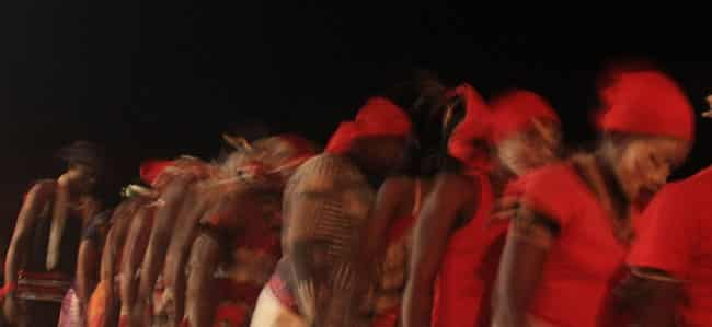 Village members dancing during an iboga ceremony