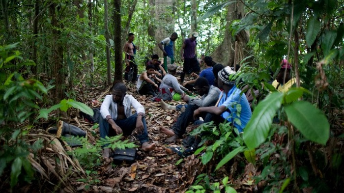 Migrants resting during the world's most dangerous hike.