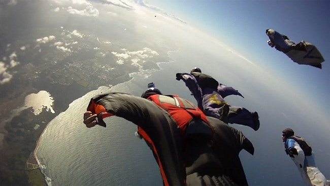Learning to wingsuit over coast