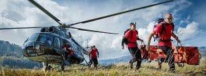 Search and rescue volunteers exit helicopter