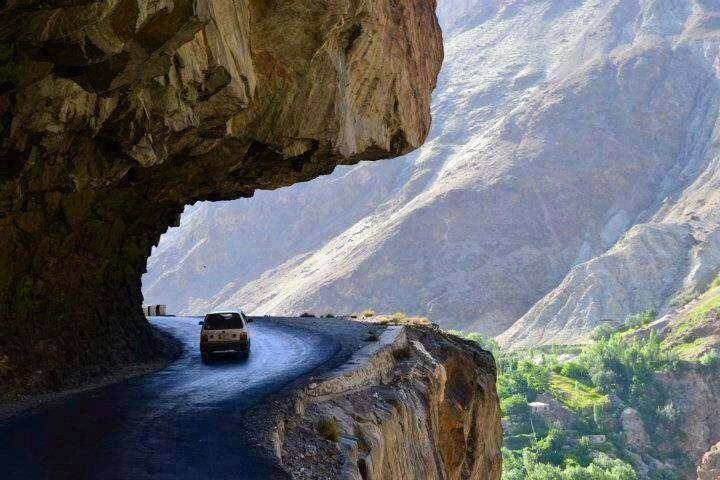 driving under rocks along Karakoram Highway